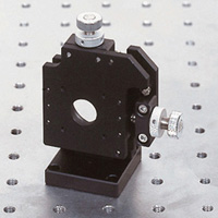 Precision cross movement holder plate type